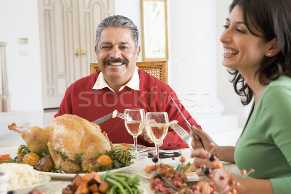 Father And His Adult Daughter Sitting Down For Christmas Dinner Stock photo © monkey_business