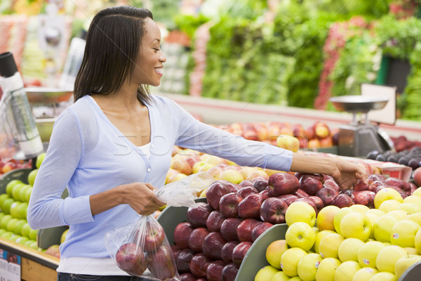 Young woman shopping in produce section  Stock photo © monkey_business