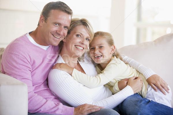 Сток-фото: семьи · сидят · гостиной · улыбаясь · женщину · девушки