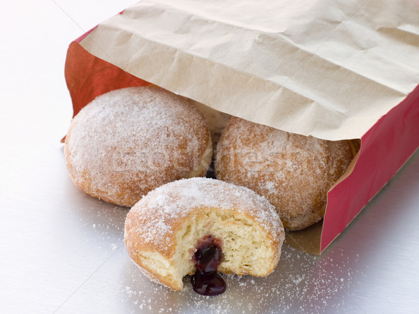 Bag Of Raspberry Jam Doughnuts With A Bite Taken Stock photo © monkey_business