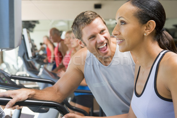 Personal Trainer Encouraging Woman Using Treadmill At Gym Stock photo © monkey_business