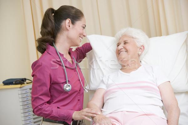Stock fotó: Orvos · nő · vizsga · szoba · mosolyog · orvosi