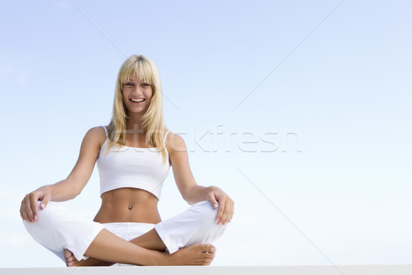 Young woman sitting cross legged Stock photo © monkey_business
