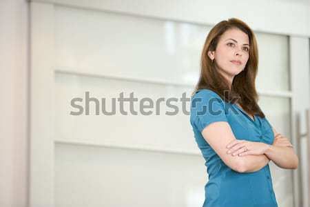 Businesswoman standing indoors Stock photo © monkey_business