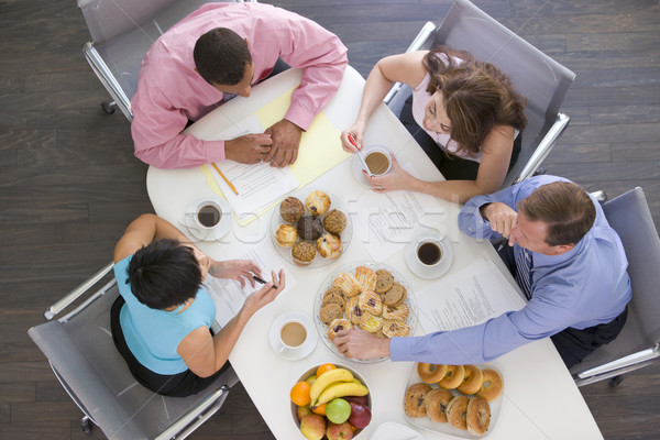 Vier boardroom tabel ontbijt business Stockfoto © monkey_business