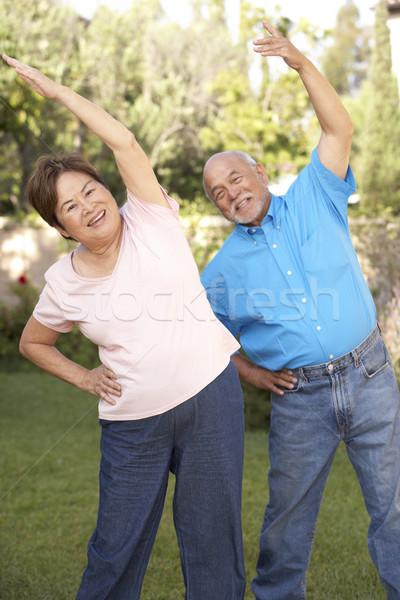 Senior Couple Exercising In Garden Stock photo © monkey_business