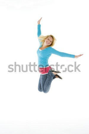 Mid Air Studio Shot Of Young Girl Jumping In Air Stock photo © monkey_business