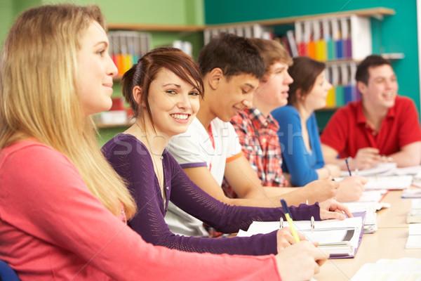 Teenage Students Studying In Classroom Stock photo © monkey_business