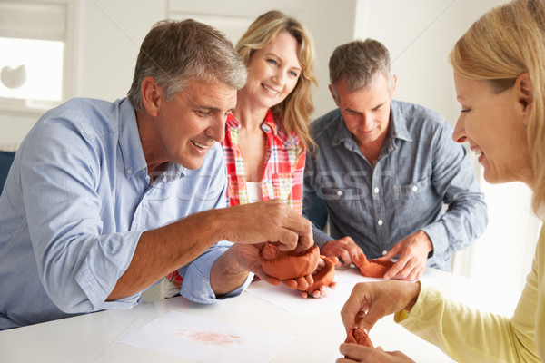 Mid age couples clay modelling Stock photo © monkey_business