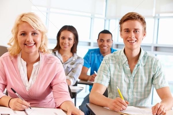 Estudantes trabalhando sala de aula mulheres feliz estudante Foto stock © monkey_business