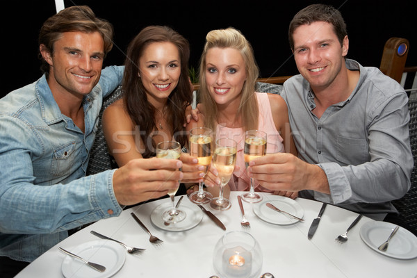 Two young couples in restaurant Stock photo © monkey_business