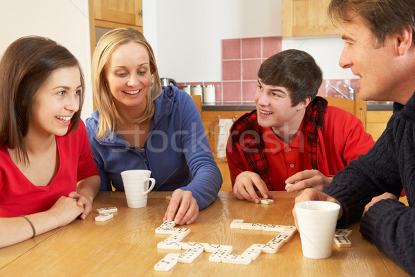 Family Playing Dominoes In Kitchen Stock photo © monkey_business