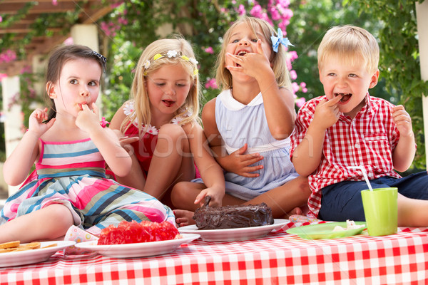 Group Of Children Eating Jelly And Cake At Outdoor Tea Party Stock photo © monkey_business