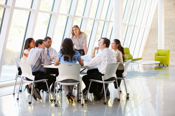Business People Having Board Meeting In Modern Office Stock photo © monkey_business