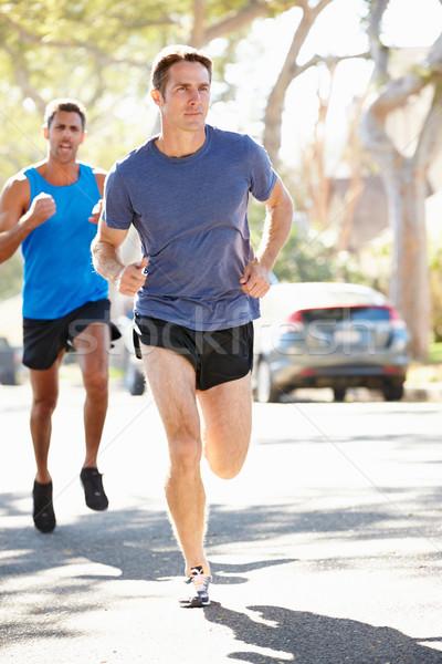 Maschio runners suburbana strada strada Foto d'archivio © monkey_business