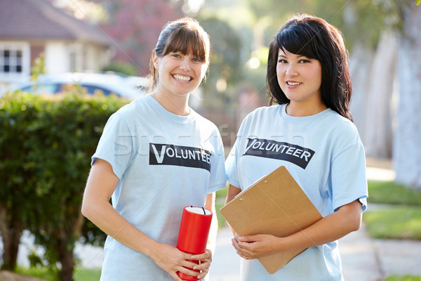 Portrait Of Two Female Charity Volunteers On Street Stock photo © monkey_business