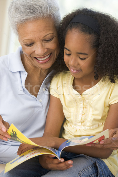 Grandmother and granddaughter reading and smiling Stock photo © monkey_business