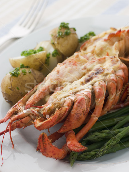 Half a Lobster Thermidor with New Potatoes and Asparagus Spears Stock photo © monkey_business