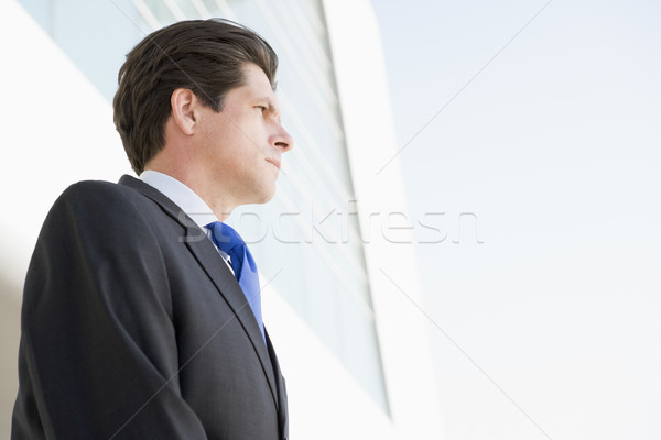 Businessman standing outdoors by building Stock photo © monkey_business