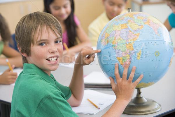 Elementary school pupil with globe Stock photo © monkey_business