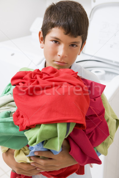 Young Boy Holding A Pile Of Laundry Stock photo © monkey_business