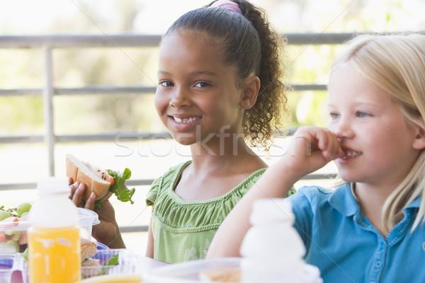 óvoda gyerekek eszik ebéd lány étel Stock fotó © monkey_business