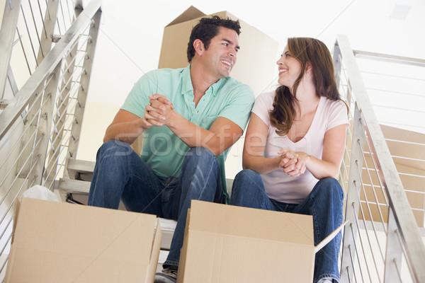 Сток-фото: пару · сидят · лестница · коробки · новый · дом · улыбаясь