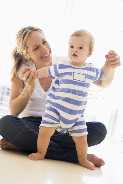 Mother and baby indoors playing and smiling Stock photo © monkey_business