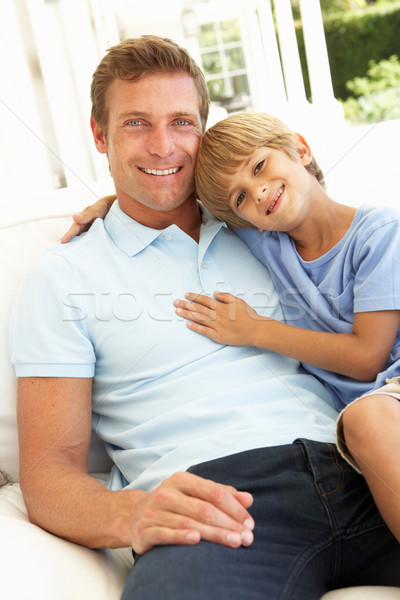 Portrait Of Father And Son Relaxing On Sofa Stock photo © monkey_business