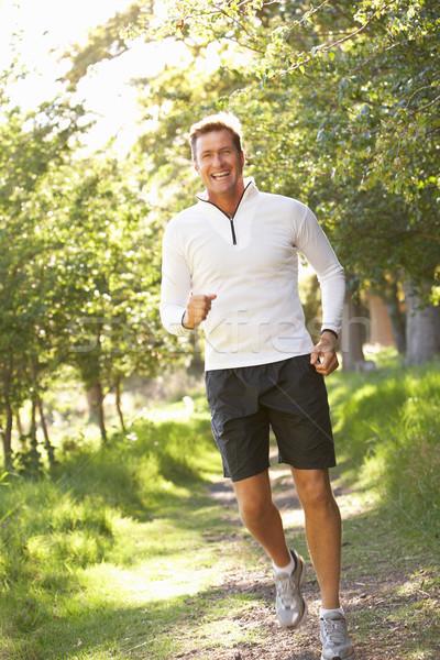 Középkorú férfi jogging park férfi boldog portré Stock fotó © monkey_business