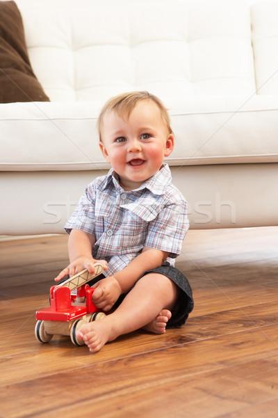 Jogar brinquedo de madeira carro casa menino Foto stock © monkey_business