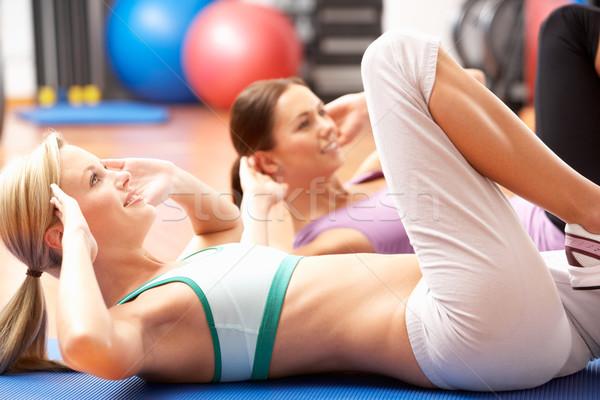 Women Doing Stretching Exercises In Gym Stock photo © monkey_business