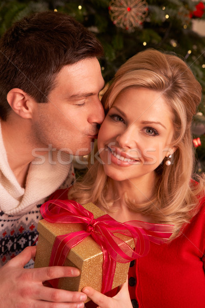 Couple Exchanging Christmas Gifts Stock photo © monkey_business