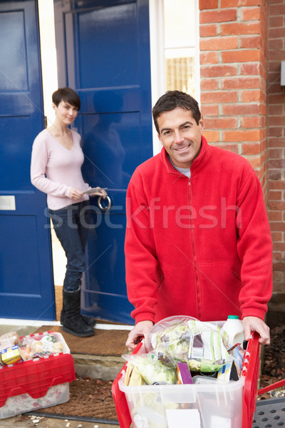 Home Delivery Grocery Driver Unloading Customer's Shopping Stock photo © monkey_business