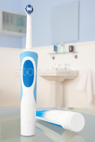 Elektromos fogkefe fogkrém kék fogak erő Stock fotó © monkey_business