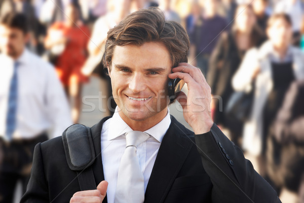 Male commuter in crowd using phone Stock photo © monkey_business