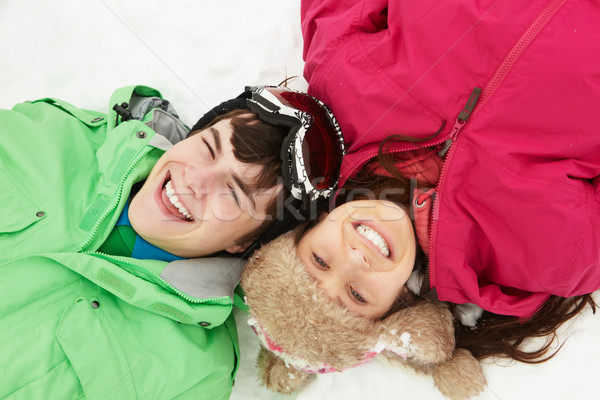 Overhead View Of Two Teenagers On Ski Holiday In Mountains Stock photo © monkey_business