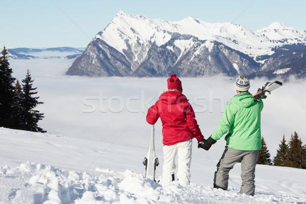 Couple Admiring Mountain View Whilst On Ski Holiday In Mountains Stock photo © monkey_business