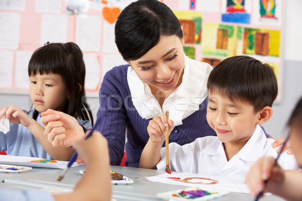 Teacher Helping Students During Art Class In Chinese School Clas Stock photo © monkey_business