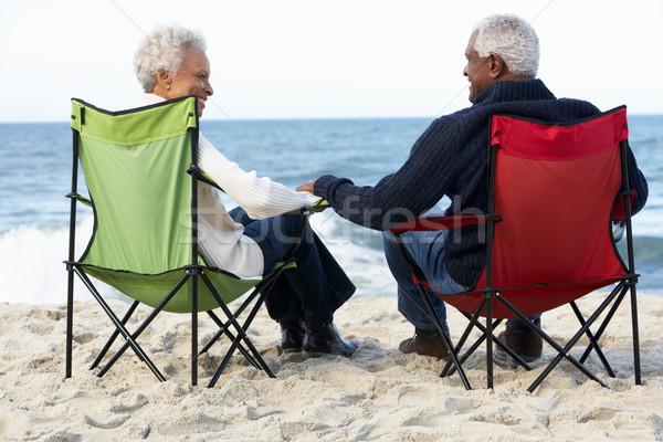 Casal de idosos sessão praia mulher mulheres homens Foto stock © monkey_business