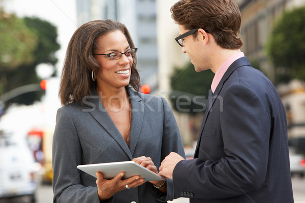 Businessman And Businesswoman Using Digital Tablet Outside Stock photo © monkey_business