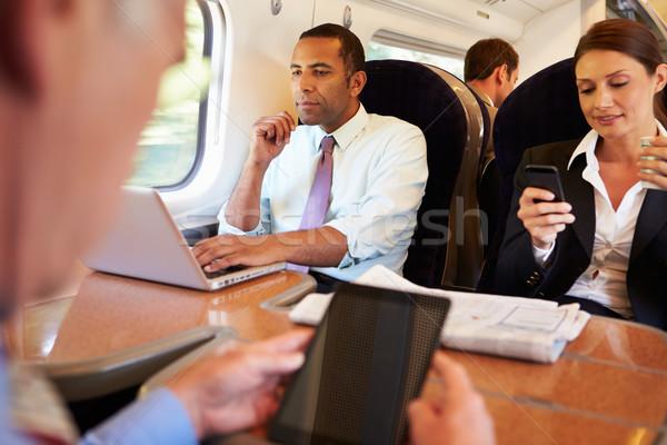 Stock fotó: üzletemberek · vonat · digitális · eszközök · férfi · nők