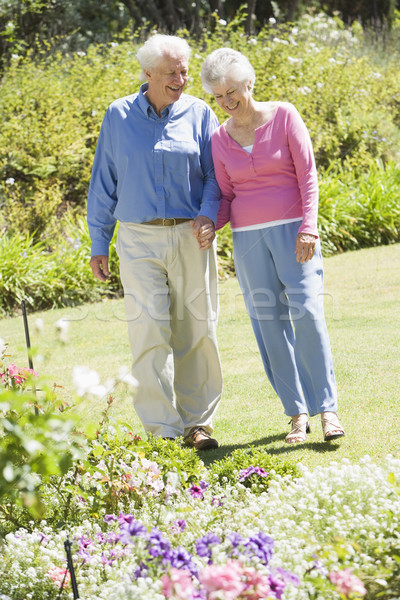Senior couple walking in garden Stock photo © monkey_business