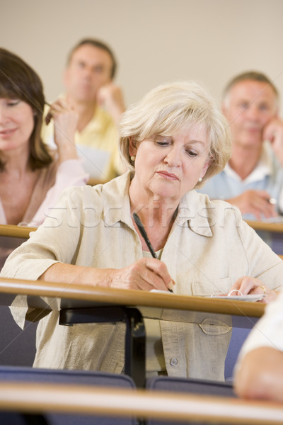 Senior woman listening to a university lecture Stock photo © monkey_business