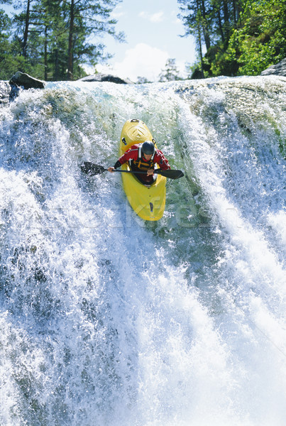 Jonge man kajakken beneden waterval sport rivier Stockfoto © monkey_business