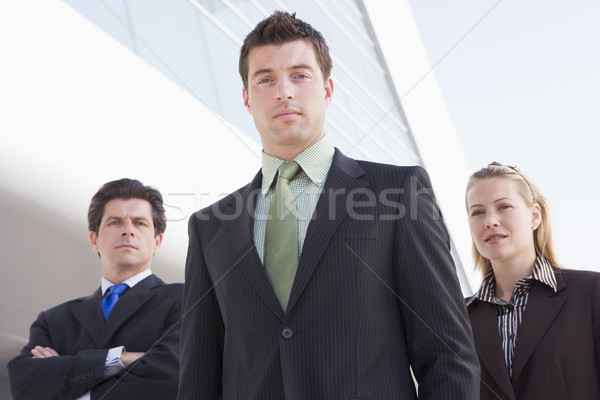 Three businesspeople standing outdoors by building Stock photo © monkey_business