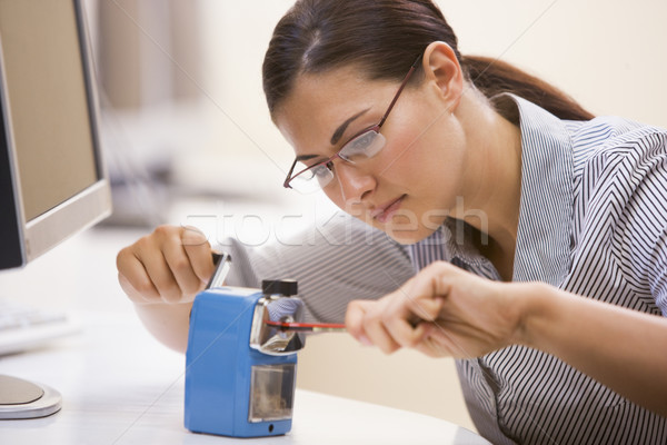 Woman in computer room using pencil sharpener Stock photo © monkey_business