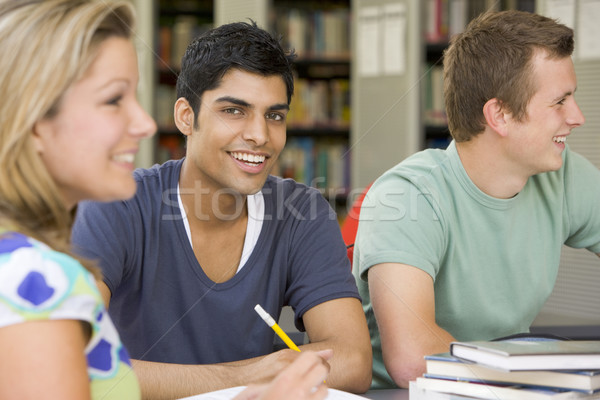 College students studying together in a library Stock photo © monkey_business