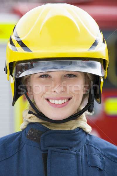 Portrait of a firefighter standing in front of a fire engine Stock photo © monkey_business