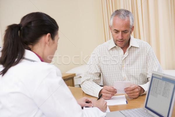 Arzt Laptop Mann schriftlich männlich Stock foto © monkey_business